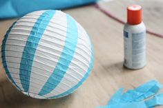 Make the stripes on our paper lantern with tissue paper.