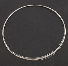 HANS APPENZELLER 1949 - Necklace of ten strings of stainless steel with a silver closure design execution 1997-1998 in original box the Netherlands
