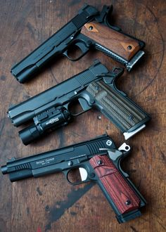 3 custom MARS Armament THUG 1911 built on a Colt 1918 reproduction (top), Dan Wesson 1911 (middle) and Nelson Custom Guns conversion 1911 (bottom). 1911 Pistol, Colt 1911, Weapons Guns, Guns And Ammo, Guns Dont Kill People, Military Guns, Cool Guns, Shotgun, Firearms