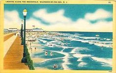 Wildwood by the Sea New Jersey NJ 1930s Along Boardwalk Antique Vintage Postcard Wildwood by the Sea New Jersey NJ 1930s Looking along the boardwalk. Unused antique vintage postcard in very good condi