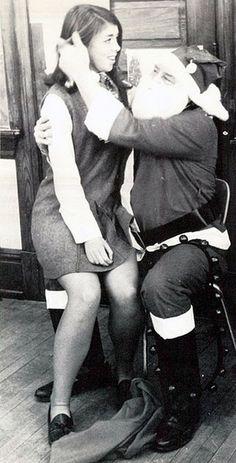 Ewwww! Santa adjusts her hair