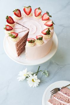 Strawberry Layer Cake Recipe with creamy heritage frosting.