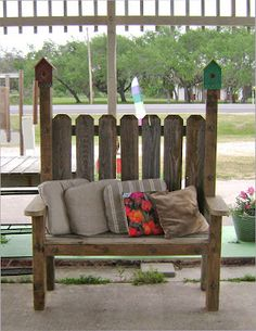 Outdoor bench built from weathered fence wood