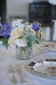Ivory garden roses with white stock, tweedia, and delphinium - shape/textures