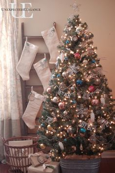 Vintage tree and ladder stocking holder. Totally doing this with our stockings!  I already have the ladder! :)