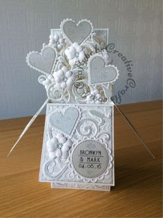 Pop up box card made using a variety of dies. For details of which ones, visit website.