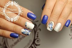 Beautiful white and blue nail art with butterfly.