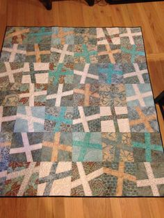 Cross quilt for Sue and Ed, made with 15 batik fat quarters.