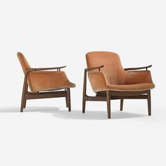 Finn Juhl lounge chairs model NV-53, pair   Niels Vodder   Denmark, 1953   teak, upholstery, enameled brass   28.25 w x 31 d x 29.5 h inches   Signed with applied distributor's label to underside of each example: [Illums Bolighus Kobenhavn].