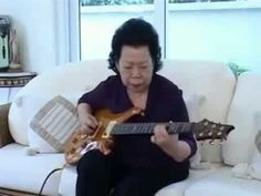 OLD WOMAN PLAYING BLUES with her guitar