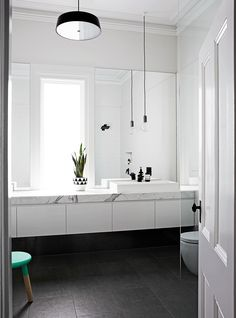 "Aussie Olympian Wins Gold on Home Renovation ""We wanted the window as the centrepiece in the bathroom, so we created a long marble bench with sinks either side,"" Johanna says. The door adds a traditional touch to the modern space. Home, Modern Spaces, Bathroom Inspiration, Interior, Bathrooms Remodel, Beautiful Bathrooms, Laundry In Bathroom, Bathroom Design, Home Renovation"