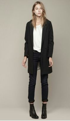 Long black jacket over white T or Shirt and slim black pants or jeans with hiking-type boots. Yes!