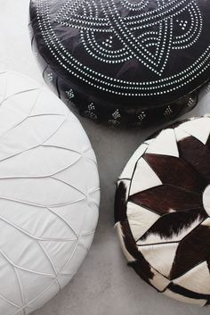 Embroidered and cowhide pouf