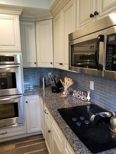 Loving the corner lazy susan bottom cabinets, glass tile backsplash and granite counter tops.