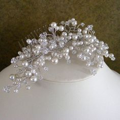 Material: pearl beads, Swarovski crystals, hair comb  Measures 3 x 5.5  Color: light ivory