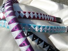 Hand ribboned and decorated on real leather. These browbands can be customised to match numnahs/saddlecloths or bandages.  I can make these in