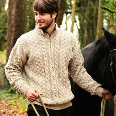 Men's Irish Aran Short-Zip Sweater - Inspired by ancient Aran and Irish heritage, this 100% Pure New Wool sweater features unique and intricate cable and honeycomb stitches, plus a contrasting color on the inside of the collar, which opens up with a short zipper. Wool is durable and naturally insulating, so this is the perfect quality sweater to throw on when the temperature drops.