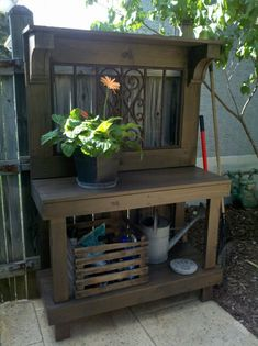 This is the beautiful potting bench that Chip built for me! He used a salvaged iron window grate from Black Dog Salvage.