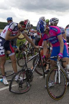 """New wheel needed. #tdf Ya think! """"Jelle Vanendert (Lotto Belisol) calls for assistance on his radio"""" Tour de France 2012 Stage 6    Photo: © AFP"""