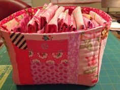 """dream quilt create: Lined Fabric Basket Tutorial.. I made a pink scrappy fabric basket, and am sharing the tutorial with you.I used the """"quilt as you go"""" method. I found the tutorial for that on Pinterest, here is the link....I cut a piece of muslin (or any other fabric you would like for your backing - it won't show) and a piece of warm and natural batting, 13"""" X 17"""". I added scraps of fabric, following the tutorial above, for """"quilting as you go""""."""