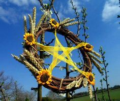 Sunflower and grain pentacle wreath   #inthehouseofmamastacey  #paganparenting…