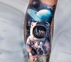 The cosmonaut on the planet tattoo by Chris Rigoni