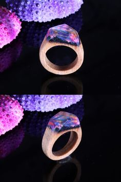 This jewelry contain the beauty and majesty of nature in all its glory allowing the wearer to always carry a piece of it with him, in turn granting him peace and calm, as well as allowing the individual to retain that connection to nature wherever he would be, whether in the sprawling urban city or a distant outland. #woodring #resinandwood #resinart #fashion
