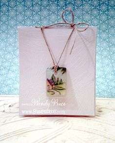 Wendy, of paper, ink and smiles blog, has created this miniature landscape using Stampendous stamps and Jewelry Resin!