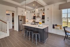 #TileTuesday features a FABULOUS kitchen design and installation by @Dream Finder Homes out of Jacksonville, Florida using our Alpine Espresso and our Semplice White in a herringbone pattern as a backsplash!  #tile #Tuesday #design #white #backsplash #herringbone #pattern #chevron #muted #tones #southernliving #FL #jacksonville #jax #interiordesign #alpine #espresso #floor #flooring #kitchendesign #southern #living #homedecor #decor #florida #plank #woodlook #inspiration #DIY