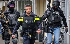 Dutch police member guiding 2 DSI operators to a hostage scene in the city of Arnhem.
