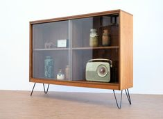 eBay watch: 1970s teak and glass display cabinet with hairpin legs