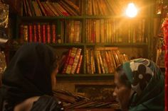 This image is from the Nizamuddin Dargah, a very popular Sufi shrine in Old Delhi, India, showing women standing in front of a bookstore. Within the shrine are prayer books and history books about Sufi saints.