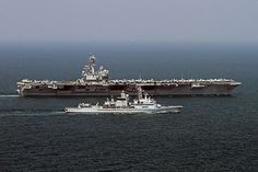 ARABIAN SEA (April 13, 2014) The French Marine Nationale anti-air frigate FS Jean Bart (D615) pulls alongside the aircraft carrier USS George H.W. Bush (CVN 77). #AircraftCarrier #BushCVN77