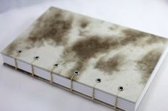 Tan and brown mottled lokta paper covers on a blank book, diary, journal, sketchbook, lunar, handmade, coptic bound, eco-friendly – no. 58 on Etsy, $17.00
