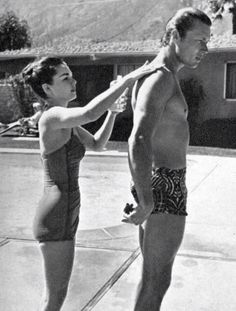 John letting his wife put on sunscreen I think. John Smith Actor, Robert Fuller, Best Hero, The Virginian, Old Movie Stars, Vintage Swimsuits, Famous Couples, Old Movies, Playsuits