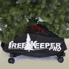 a rolling storage container for an artificial x-mas tree.  You roll the tree out and lock the wheels!