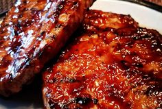 World's Best Honey Garlic Pork Chops A quick and simple grilled pork chop that e. - World's Best Honey Garlic Pork Chops A quick and simple grilled pork chop that everyone ^^ CLICK - Pork Chop Recipes, Meat Recipes, Dinner Recipes, Cooking Recipes, Cooking Pork, Dinner Ideas, Grilled Recipes, Barbecue Recipes, Smoker Cooking