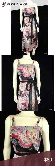 """Kay Unger Silk Fit n Flare Art Print Dress Lined, 100% silk  Approximate Measurements: pit to pit 15"""", around waist 24"""", around hips 32"""", length (nape of neck to bottom hem) 39""""  Beautiful multi-color pure silk sleeveless belted fit and flare cocktail dress.  Black silk tie waist belt, boned bodice, back center hidden zip-up and hook closure, a-line, gorgeous print in pinks, purple, blue, green, yellow, white, red and black.  Flattering style for evening, special occasion. Kay Unger Dresses…"""