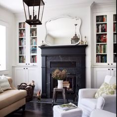 Love big fireplaces with shelves on either side.