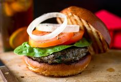 """NYT Cooking: These hamburgers — cut through with roasted mushrooms — are inspired by the versions cooked by the chef Scott Samuel of the Culinary Institute of America. The recipe came to The Times in in Martha Rose Shulman's """"Recipes for Health"""" col Roasted Mushrooms, Stuffed Mushrooms, Stuffed Peppers, Burger Recipes, Vegetarian Recipes, Barbecue Recipes, Meat Recipes, Healthy Recipes, Recipies"""