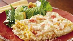 "It's divine!  Seafood smothered in creamed sauce and layered with a favorite pasta makes a ""company's coming"" favorite!"