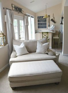 i love this chair and ottoman, but not in white. would like a pattern better. #livingroomremodelling #ComfyChair