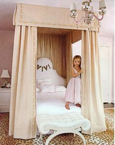 So Glamorous!! Girl's bedroom with canopy and upholstered headboard. Leopard carpet.