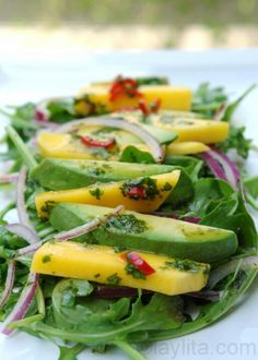 Mango, avocado, and arugula salad with spicy orange dressing.  From Laylita's Recipes.  Delicious Ecuadorian recipes.