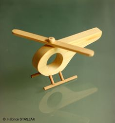 Wood helicopter wood toy hand made jouet en bois hlicoptre en bois woodhelicopter woodtoy handmade jouetbois these wooden toys are so pretty they re basically works of art Making Wooden Toys, Handmade Wooden Toys, Wooden Crafts, Wooden Children's Toys, Wooden Airplane, Wood Toys Plans, Wooden Truck, Scrap Wood Projects, Woodworking Toys