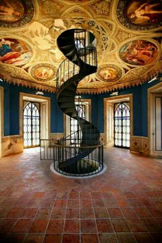 spiral staircase heading up through a beautifully painted ceiling like a stairway to the heavens | Umbria, Italy
