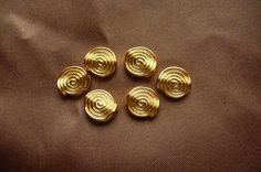 Buy Bead, ZincRich Pewter, Gold Plated, 11x4mm, Doublesided, Flat Round, with Spiral Design, Pkg Of 10 by darsjewelrysupplies. Explore more products on http://darsjewelrysupplies.etsy.com