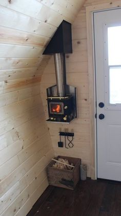 is the new Acorn Micro Cabin from Forest Trek Woodwork in Alberta . This is the new Acorn Micro Cabin from Forest Trek Woodwork in Alberta . This is the new Acorn Micro Cabin from Forest Trek Woodwork in Alberta . Tiny Cabins, Tiny House Cabin, Tiny House Living, Tiny House Design, Small Living, Tiny House Wood Stove, Small Garden Cabin, Rv Wood Stove, Wood Stove Decor