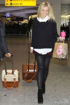 Mollie King at Heathrow Airport in London, England - December 12, 2012