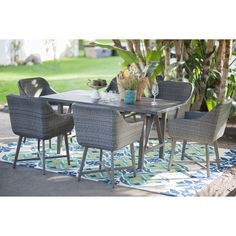 Belham Living Adissinia 7 Piece All Weather Wicker and Concrete Patio Dining Set | from hayneedle.com